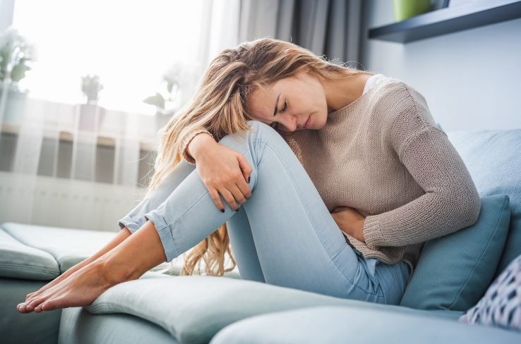 Woman suffering from period pain